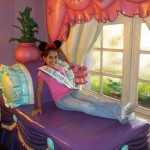 Caitlyn resting on Minnie Mouse's Chaise