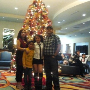 Happy family by the X-mas tree*