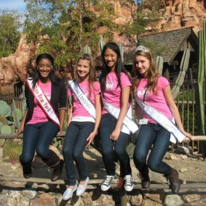 "Jr.Teen Team Service Members, Nadgeena Jerome, Tiffany Luk, and Taylor Longbrake pose with Team Achievement Member Lauren Schwartzberg in front of ""the wildest ride in the wilderness!"""