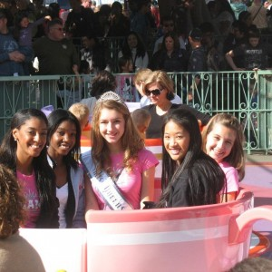Jr.Teen Team Service Members, Nadgeena Jerome, Tiffany Luk, and Taylor Longbrake join Team Achievement Member Lauren Schwartzberg for a fun ride on the Tea Cups!