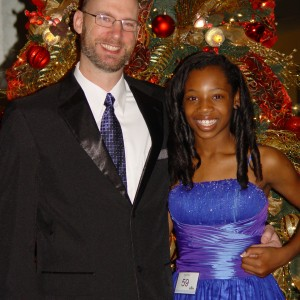 Almost ready for the formal wear competition, Hailey Kilgore poses with her father Eric.