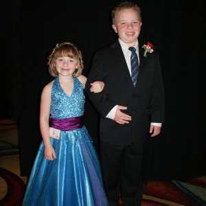 Princess Zoe A. escorted by her brother Zach