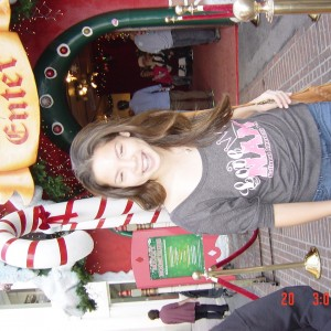 In front of decorations at the grove
