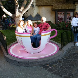 Sam and family in the Disney teacup