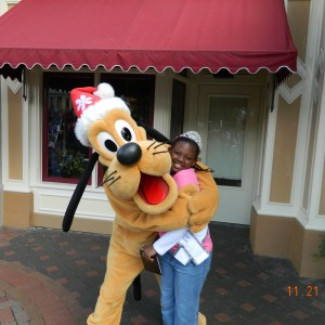 Mariah gets a hug from Pluto