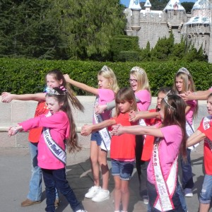 JPT Team Confidence practicing their chant in front of Cinderella's castle.