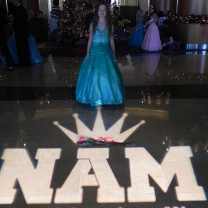 JPT Bonnie Bishop in front of the NAM light in the lobby of the Marriott.