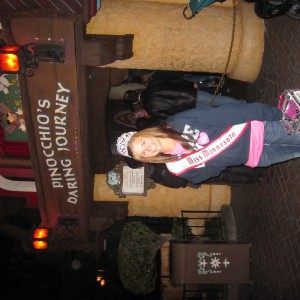 MN Jr. Teen in front of Pinnochio ride