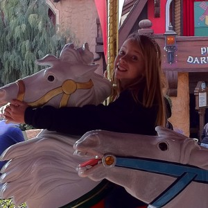 #43 Jr PreTeen Mia Gryniuk on the Merry Go Round at Disney