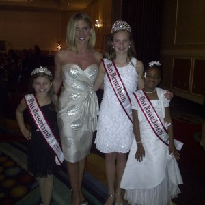 Girls posing with Emcee Joy Suprano