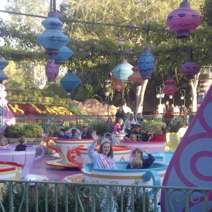 Skyler and her brothers riding the iconic teacups!