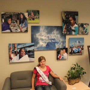 Rachel Marx (preteen, Leadership) visits the Girl Scout LA Headquarters.  Note the sign says Leadership, Life Skills, and Community Service.