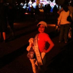 Miss Dublin posing in front of the Disney Castle