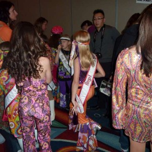 Team Character Making the dress on Miss Nebraska