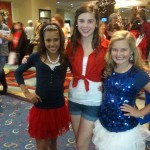 Kaitlin Kanfield and team service gals in patriotic outfits
