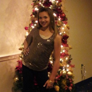 Victoria Newlove posing in front of the Christmas Tree