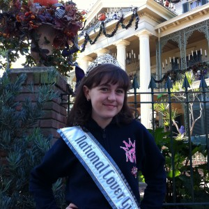 Pre-Teen Kyra Walters in front of Haunted Mansion