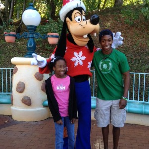 Tiana McGee and her brother with Goofy