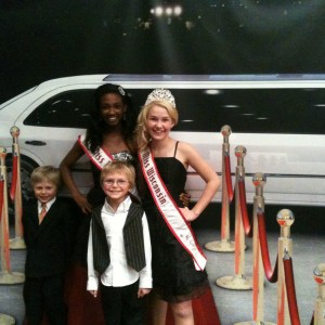 Miss MO Pre-teen, Madison Shead, and NAMily Miss WI Pre-teen, Brittany Georgia, with her little brothers on the red carpet