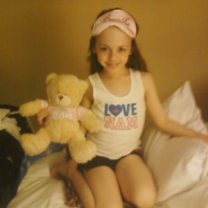 Isabella Conner in her NAM bedtime wear with her NAM bear.