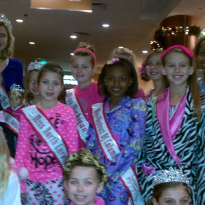 Girls posing with National Queens before PJ rehearsal