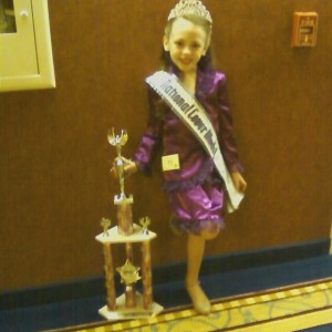 Isabella conner and National Cover Model trophy before interview with judges at nationals in California.