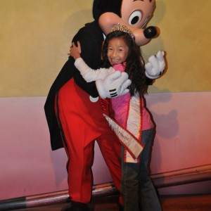 Miss Florida hugging Mickey Mouse