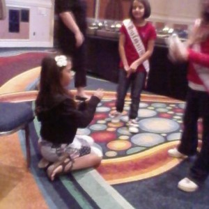 Miss Iowa princess Tanae Thiravong having fun at the patriotic rehersal with some new friends!