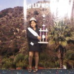 Holding the National Cover Girl trophy