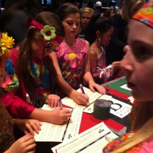 Ariana Muehlenbein and her team having fun at the 70's theme party