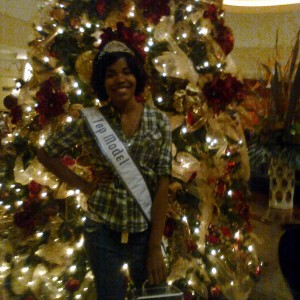 Spechelle Goodwin posing with Christmas tree