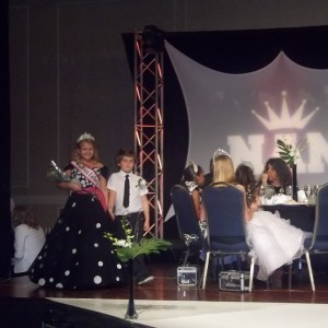 Abi Lange Miss Colorado JPT is escroted by her friend Tarik at the Thanksgiving banquet