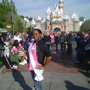 Autumn Cooke posing in front of the Disneyland Castle
