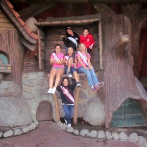 Pre-teen girls making memories at Winnie the Pooh's treehouse