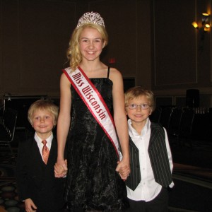 Miss Wisconsin Pre-teen, Brittany Georgia, with her two brothers during the Thanksgiving banquet