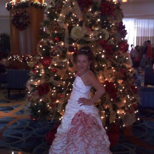 Paige Romero in front of Christmas Tree