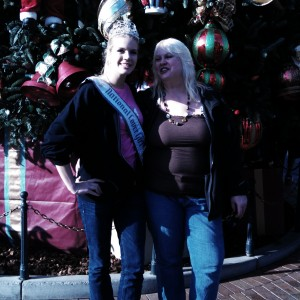 With mother in front of the Disney tree