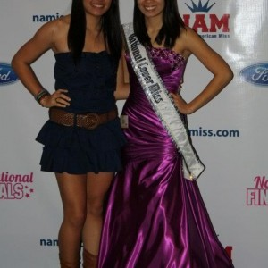 National Cover Miss Megan Viola-Vu with little sister after formal wear competition