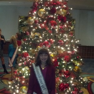 Shining star in front of the tree!