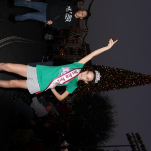 Miss NY JPT with freshly-lit Christmas tree at Disneyland