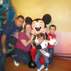Miss Arizona Gabriela Bustillos and family with Mickey Mouse.