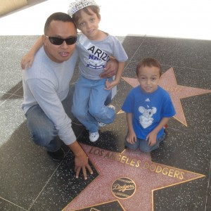Miss Arizona Gabriela Bustillos and family next to the Dodger's star.