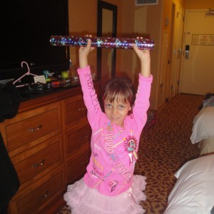 Miss Arizona Gambriela Bustillos proud of her spirit stick she got at the Birthday Theme Rehersal