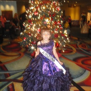 Miss Arizona Gabriela Bustillos next to a Christmas tree