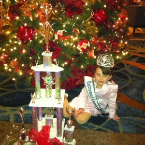 Princess Baylie Hileman, National Cover Miss 2012-13 in front of Christmas tree
