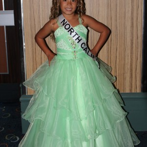 Emery Ricks CA JPT queen formal wear