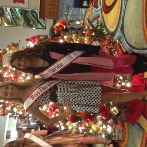Amber Flynn and Megan her FL sister queen in front of the beautiful Christmas tree