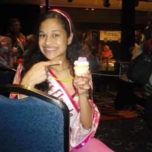 Rosalind Alifonso Miss Florida 2012-2013 enjoying a cupcake for NAM's 10th Bday