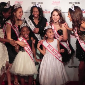 Maryland NAM Queens having a laugh in front of the Red Carpet Backdrop