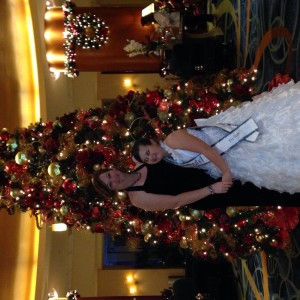 Emma Schroeder and mom with the Christmas tree